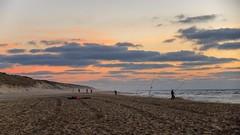 Au fil de l'eau...... (Isabelle Gallay) Tags: ocean beach plage fisher pecheur sunset people aquitaine gironde lacanau fuji fujifilm fish clouds nuages soleil nature landscape paysage