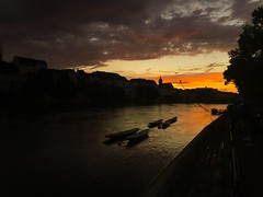 Basel - River Rhine (Sira2015) Tags: sun sunsetsky orangesky sunsets tranquility peaceful serene beautiful ngc catchycolors colors colorful beautifulsunset skies sky iphonesky evening swiss baselriverrhine dusk iphonecamera iphone basel riverrhine switzerland suisse sunset iphone6s photographic boat boats architecture