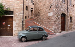 Guardian (music_man800) Tags: italy italia holiday road car classic vintage antique fiat 500 fiat500 vehicle motor roads assisi umbria hill hilltop town city september summer autumn bricks stairs urban canon 700d photography edit creative gimp gimp2 light lighting natural day signs door steps street gold stone house building secret passage