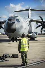 RAF Ground crew member waits to fit chocks to taxing A400M (ATLAS). (aeroman3) Tags: royalairforce raf equipment aircraft transport a400m atlas squadron sqn operationalconversionunit airtransport personnel nonidentifiable man