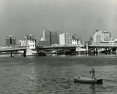 Platt Street bridge crossing the Hillsborough River - Tampa (State Library and Archives of Florida) Tags: florida tampa hillsboroughriver skylines plattstreet cities centralbusinessdistricts boats fishermen