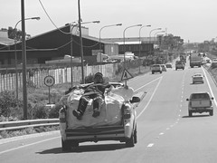 Flat out (Englepip) Tags: road urban van car bakkie pickup worker transport lying busy blackandwhite