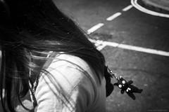 fleeting moment (jrockar) Tags: streetphotography documentary photography moment fleeting candid instant snap shot decisive teddy bear keyring bw mono blackandwhite canon 5d mk mark 3 iii stm 40 prime lens standard motion blur woman girl hair midair flight jrockar janrockar idiot ordinarymadness london