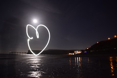 Glowing Love, Under the moon at Saltburn Pier. (stu105e) Tags: moonlight saltburnbythesea saltburn pier night d5300 nikon longexposure paintingwithlight love loveheart
