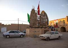A wooden nakhl on a parking during muharram, Yazd province, Yazd, Iran (Eric Lafforgue) Tags: 0people architecture ashura buildingexterior car cars coffin colorimage copyspace cultural culture day flags funeral gardani history horizontal hussain imamhussein iran iranian iranianculture islam islamic middleeast muharram nakhl nopeople nobody outdoors persia religion shia shiism shiite tradition traditionalculture yazd yazdprovince ir