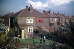 img217 (foundin_a_attic) Tags: april 1973 street houses homes fashion eveyday life england suburbs garden coupple lawn yellow red house home trees british