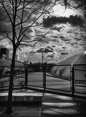 Outside the stadium (GBaker63) Tags: toronto building stadium bicycle cloud shadow light bw olympus penf