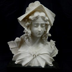 ART:  Marble bust of a woman.