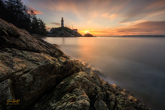 Here Comes The Sun (erwin.delfin_photography) Tags: lighthouse westvancouver beautifulbritishcolumbia vancouver sunrise rocks water waterscape clouds pointatkinson canon ishootcanon