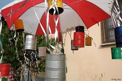 composizione con barattoli colorati (Clay Bass) Tags: 1855 castellar cans fuji jpg light natural scarecrow umbrella xm1