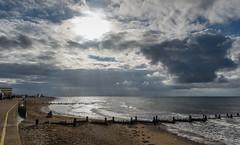 The groynes at Hunstanton (Ralph Green) Tags: england hunstanton norfolk thewash clouds fishing groynes sand shoreline sun sunsrays waves