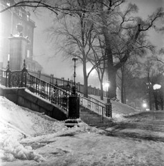 020459 11 (ndpa / s. lundeen, archivist) Tags: nick dewolf nickdewolf blackwhite photographbynickdewolf tlr bw 1959 1950s february winter boston massachusetts beaconhill night nighttime wintersnight park common bostoncommon tree branches snow snowy snowfall trees film 6x6 mediumformat monochrome blackandwhite light lights steps fence railing ironwork beaconstreet walnutstreet path pathway building