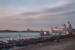 "Sunrise over ""Santa Maria della Salute"" (Valentina Conte) Tags: sunrise dawn venice gondolas canalgrande canal water sea lagoon light colorful landscape piazzasanmarco travel tourism sun sky clouds beautiful fairytale longexposure magical church santamariadellasalute seasunclouds"
