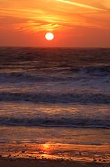 The rising sun reflected on the golden strand (Kirkleyjohn) Tags: sea sky sun beach water sunrise dawn suffolk waves daybreak lowestoft kirkley