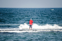 The fisherman in red (with boats) (Sherif Wagih) Tags: ocean sea alexandria lost island fishing fisherman waves crash egypt egyptian middle surrounded crashing