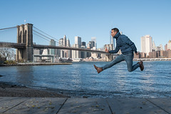 Jumping on the Edge of the City (Carlos (CR 76)) Tags: nyc newyorkcity bridge usa brooklyn photography jump manhattan salt fujifilm hop leap