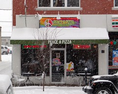 Main Street in the Snow: Sorry We're Open (The Flying Inn) Tags: street food snow signs weather restaurant mainstreet neon main pizza snowing delaware newark