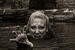 Zombie in the river (Vagabond Photography WI) Tags: park blue blackandwhite bw black fall water wisconsin flesh portraits river photography blackwhite tim model eyes zombie blueeyes september blond brains editing iverson creature janelle hdr stevenspoint grasping vagabond creaturefromtheblacklagoon uwsp 2013 gumz iversonpark vagabondphotography timgumz