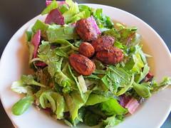 Local salad with teriyaki almonds & garlic-ginger dressing (Joel Abroad) Tags: food vegetables hawaii restaurant ginger salad lettuce greens vegetarian almonds garlic honolulu teriyaki rawvegan greensvines