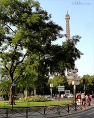 Eiffel from Place des Martyrs Juifs du Velodrome D'Hiver (eutouring) Tags: travel trees paris france tree tower sign square eiffeltower eiffel signpost placedesmartyrsjuifsduvelodromedhiver