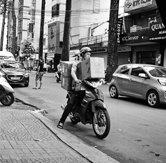 Making a delivery (mteckes) Tags: hasselblad 500c bw kodak kodaktrix trix ziessplanar80mm28 zeiss saigon hochiminhcity vietnam film blackandwhite monochrome