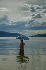 In case of rain ;) (janne.skei) Tags: girl bath umbrella thunder sky clouds water sea seascape people blue reflectoin waterdroplets rain drops outdoor norway moment magic minimalistic mountains panasonic lumix