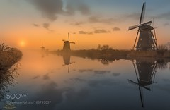 Fading Colors II (DRoofing163) Tags: sunrise morning reflections sunset color water travel sun colored gold canal mills golden hour windmills holland netherlands dutch kinderdijk wbpa herman van den berge
