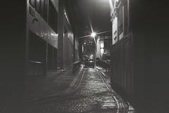 London At Night (goodfella2459) Tags: nikon f4 af nikkor 50mm f14d lens kodak trix 400 35mm black white film analog london night street car road darkness milf