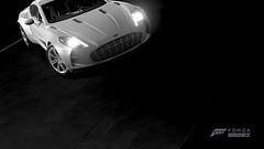 PMC Week 6   #1   FH3 (Mr. Pebb) Tags: xboxonephotomode xboxone turn10 t10 playgroundgames photomode forzahorizon3 fh3 forza horizon3 stock stockshot videogame rearwheeldrive rwd blackandwhite bw desaturated astonmartinone77 british supercar frontengined v12