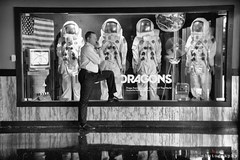 dragon's den (lynn.h.armstrong) Tags: imagine dragons top world man person business phone leg up talking cellphone mobile black white bw wb monochrome astronauts us flag display hard rock hotel casino las vegas nevada lobby entrance tv fan space suits