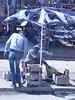 The tattered umbrella (prondis_in_kenya) Tags: kenya nairobi shortrains umbrella break tatter broken shoeshine stall blue