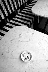 The last cig (PM Kelly) Tags: paris bnw bw blackandwhite blackwhite caf coffee table smokers ashtray cigarette strip street photography