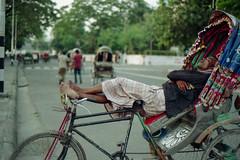 Let me take a Nap... (Sheikh Shahriar Ahmed) Tags: street sleeping film analog 50mm nikon nap sleep candid streetlife fujifilm dhaka f18 bangladesh puller riksha lungi nikonf6 af50mmf18d fujicolorc200 dhakadivision ducampus epsonv330 sheikhshahriarahmed