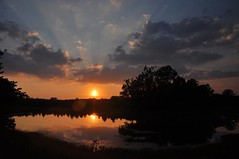 the day saved its best moment for last (christiaan_25) Tags: blue sunset sky orange sun lake color reflection nature water beauty silhouette clouds evening day glow cloudy rays sunbeams crepuscular