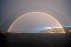 The glowing gate to Bergen (Aviation & Maritime) Tags: norway shower rainbow fjord bergen regnbue rainshower byfjorden