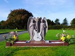 Cheltenham, Gloucestershire (Oxfordshire Churches) Tags: uk england unitedkingdom gloucestershire panasonic angels monuments guitarists cheltenham fenderstratocaster memorials famousgraves mft johngraham celebritygraves johnward micro43 microfourthirds theramrods lumixgh3