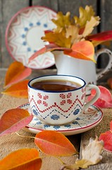 A cup of tea on the table with autumn leaves (teleginatania) Tags: life wood old november autumn red orange brown white plant color tree fall leave texture cup nature coffee leaves yellow closeup vintage season table gold golden wooden still healthy october colorful pattern natural tea drink background grunge seasonal decoration retro foliage colored autumnal herbal