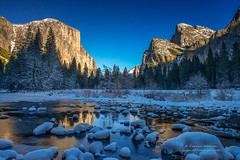 Yosemite in Blue and Gold (Darvin Atkeson) Tags: winter sunlight snow mountains reflection forest river landscape frozen nationalpark nevada rocky merced sierra valley yosemite icy snowfall bridalveil elcapitan valleyview snowscape darvin atkeson darv liquidmoonlightcom lynneal