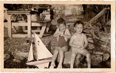 Little Children in Bathing Suits With Toy Sail Boat (oldsailro) Tags: park old boy sea summer people sun lake playing beach water pool girl sunshine youth sailboat race vintage children fun toy boat miniature wooden pond model waves sailing ship time yacht antique group boom mast hull keel