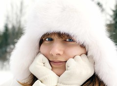 Portrait of young girl (Anjelagr) Tags: christmas blue winter portrait people woman white holiday snow cold tree cute nature girl beautiful beauty smile face up hat smiling fashion closeup female hair season fun happy person snowflakes one clothing model pretty close adult natural outdoor head expression background coat year joy young style happiness clothes teen attractive cheerful teenage caucasian vision:food=0538 vision:outdoor=0687