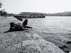 Afternoon Snooze (scobbiebhoy) Tags: bosphorus istanbul turkey streetphotography shore street snooze shoreline sleep bw blackandwhite