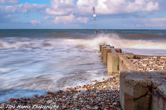 IMG_0939 (taraharris1) Tags: beach beachhut sand sea ocean lighthouse cliff outside landscape nature groyne structure blue norfolk england waves sky day nopeople country