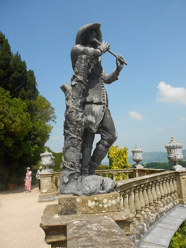 Powis Castle. Lead statue of flute player.