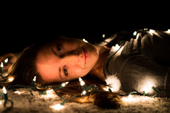 Day Sixty Seven (k.a.craig) Tags: woman girl lady female people person laying lying floor carpet smile beauty beautiful lights christmas brunette contrast 365