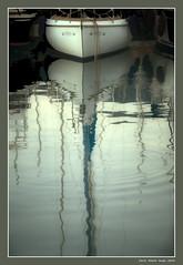 Between the boats at twilight (cienne45) Tags: reflections riflessi boat barca twilight crepuscolo illusione illusion fantasia movimento movement acqua water riflesso dark mysterious