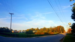 just before sunset (yetanotherstephanie) Tags: partlycloudy november seriesphotography landscapes smalltown bolivarmo ruralmissouri watertower fall autumn trees frontporch samsunggalaxys6