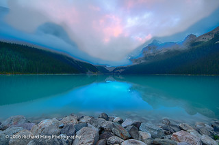 Lake Louise under the clouds at sunrise