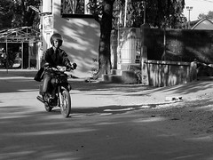 motorcyclist (.emong) Tags: street people bw monochrome sanantonio lumix philippines panasonic motorcycle zambales lx3