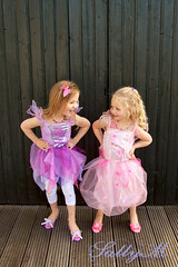 Attitudes (SallyMPhotography) Tags: girls friends playing smiling closeup sisters children fun outdoors pretty natural dressup lifestyle climbing spontaneous 5yearold realmoment fairycostumes