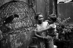 Facing one's own (shankarsarkar) Tags: portrait india blackwhite kid women young mother relationship kolkata intimacy westbengal sonagachi redlightarea otherkeywords trafficked